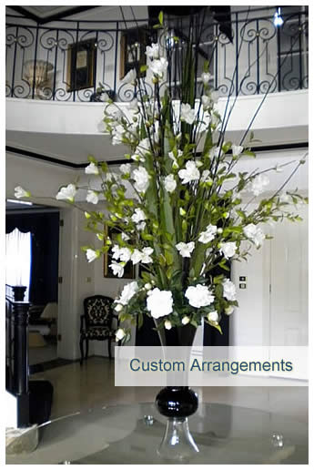 Custom floral arrangement using artificial plants and flower